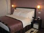 Epoque Hotel, Bucharest - bedroom in deluxe suite