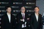 Romain Grosjean, TAG Heuer's CEO Stephane Linder and Sebastien Ogier in Paris at opening of new store