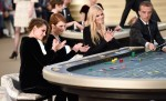 Kristen Stewart, Julianne Moore and Lara Stone playing roulette on the catwalkChanel show, Autumn Winter 2015, Haute Couture