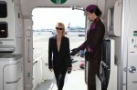 Amber Valletta boarding Etihad Airways NYFW branded aircraft