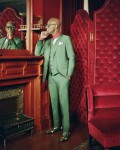 Dapper Dan in his Atelier in Harlem backed by Gucci